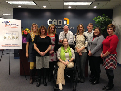 Erika Brannock was gracious enough to meet the CADD Foundation committee members in person to accept its donation, and shared her inspiring story of perseverance and strength.  (PRNewsFoto/CADD Microsystems)