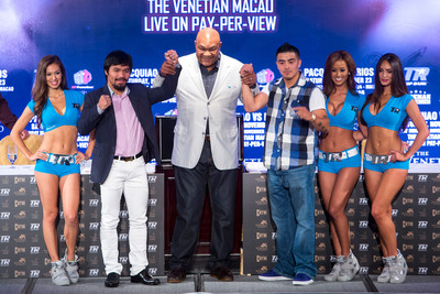 Heavyweight boxing legend George Foreman (centre) raises the arms of Manny Pacquiao (left) and Brandon Rios (right), at a press conference at The Venetian Macao July 27 promoting the Nov. 24 PACQUIAO VS. RIOS: The Clash in Cotai.  (PRNewsFoto/Sands China Ltd.)