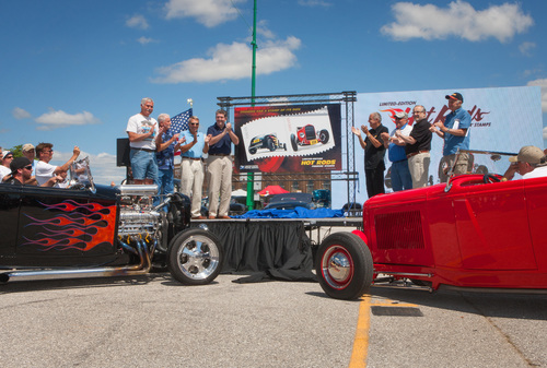 """L to R: Retired U.S. Postal Service (USPS) employees Allan Grimes, Michael Hill, Al Lariviere and current USPS Postmaster General Patrick R. Donahoe help unveil the new Hot Rods Forever(R) stamps from the U.S. Postal Service along with Barry Meguiar, """"Car Crazy Television"""" host, Jerry Kennedy, NSRA Special Events Director, Cary Brick, former Citizens' Stamp Advisory Committee member and Mel Sparrough, retired USPS employee at the NSRA Street Rod Nationals East plus in York, PA on Fri., June 6, 2014. The limited-edition stamps honor ..."""