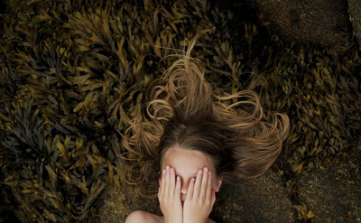 """Girl in Seaweed"" -- the 2009 National Geographic International Photography Contest for Kids grand-prize winning image by Simon Nikolai van Lierde, of The Hague, Netherlands. Image courtesy of National Geographic.  (PRNewsFoto/National Geographic Society)"