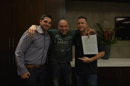 UFC President Dana White signs new contract with MusclePharm. (PRNewsFoto/MusclePharm Corporation) ...