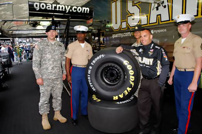 Seven-time NHRA Champion Tony Schumacher helps to kick-off the 2011 Goodyear Support Our Troops Program alongside Master Sergeant Terrence Brown and Sergeant Kurt Hightower of the U.S. Marine Corps and Sergeant Dustin Goddard and Drill Sergeant Amber Jones of the U.S. Army. Goodyear, exclusive tire supplier of NASCAR's three major national series and NHRA Racing's Top Fuel and Funny Car series, is honoring and supporting U.S. Armed Forces by transforming the appearance of all related racing tires over the September 16th weekend. This marks the second straight year that Goodyear has altered the sidewalls of its race tires to honor U.S. troops.