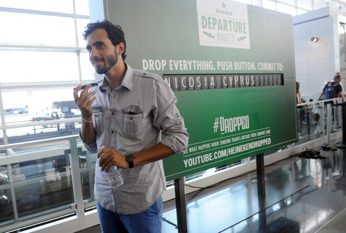 Greg Vosits, winner of Heineken Departure Roulette calls family to tell them he's going to Cyprus.  (PRNewsFoto/Heineken USA)