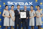 Edward Plaisted, president of SKYTRAX, a leading research firm with a focus on airline and airport services, presents the Five-Star Airline award to Hainan Airlines president Xie Haoming