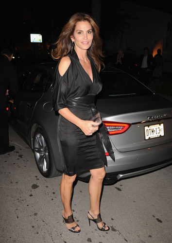 Cindy Crawford arrives to Art Miami's VIP Preview Opening Night in the all-new Maserati Quattroporte GTS. ...