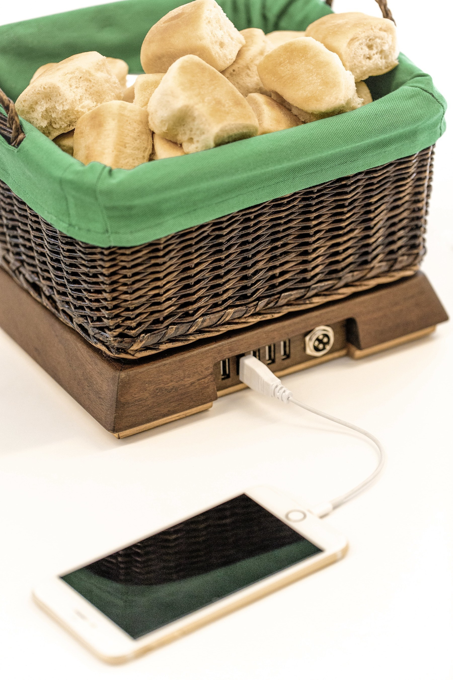 Sister Schubert's Basket of Warmth is no ordinary bread basket. As the centerpiece to a holiday table, or any dinner table, the Basket of Warmth uses the very electronic devices that create distractions at dinnertime to keep freshly baked Sister Schubert's dinner rolls warm. Guests simply plug their devices into the basket during dinner. The devices stay safely tucked away; recharging while the dinner rolls stay warm.