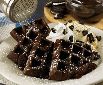 For a limited time, Outback Steakhouse(R) will offer OREO(R) Cookies 'N Cream Waffles dessert which features warm chocolate waffle cakes with vanilla ice cream, OREO(R) cookie crumbs, whipped cream, and house made chocolate sauce.  (PRNewsFoto/Outback Steakhouse)