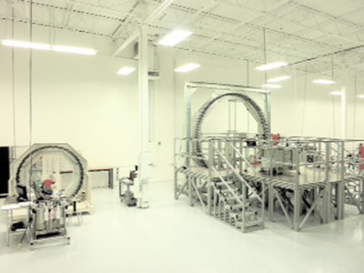 Based in Quakertown, PA, US BioDesign LLC is a highly capable, cost efficient provider of engineered fabric structures to the global medical device industry, specializing in braided and non-woven components. The medical braiders seen here are used to braid implantable grade polymer and metal wires and yarns. Pictured at right is the world's largest medical braider, capable of producing structures with pore size as small as 60 microns and suitable for cardiovascular and neurovascular applications.  (PRNewsFoto/US BioDesign LLC, Image Courtesy US BioDesign)