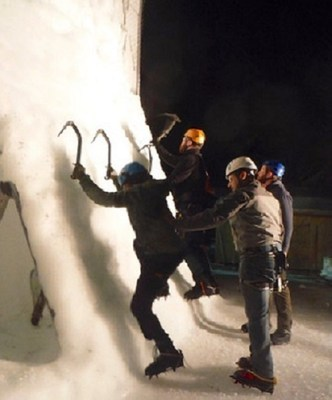 Through bonding and camaraderie, wounded veterans help each other conquer the ice wall.