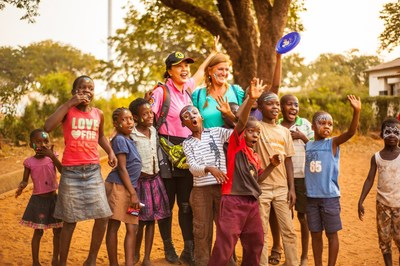 Children from Rose of Charity Orphanage and the surrounding neighborhood together with WorldVentures Foundation Executive Director Gwyneth Lloyd on the right, and Jennifer Ho on the left
