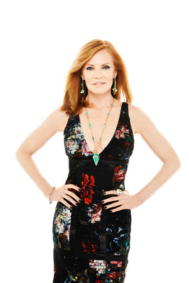 """2014 American Gem Trade Association Spectrum Awards(TM) jewelry worn by Intelligence actress, Marg Helgenberger. """"Spring time"""" earrings by Gregore Joailliers, """"Kryptonite Pyramid"""" necklace by Lauren Harper Collection, """"Swirling"""" ring by Metal Kinetics and bracelet by Metal Art Studio Fine Jewelry. Floral, pleated chiffon gown by Roberto Cavalli (available at Saks Fifth Avenue). Photo by Brian Bowen Smith. Styled by Tod Hallman. (PRNewsFoto/American Gem Trade Association) (PRNewsFoto/AMERICAN GEM TRADE ASSOCIATION)"""