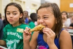 Yum! Elementary school student at a Des Moines public school enjoying a sustainably sourced drumstick.