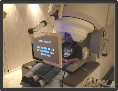 Child in MEG machine that measures brain's magnetic activity