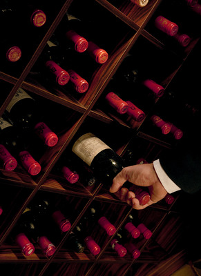 Selecting wine for a Crystal Vintage Room Dinner.  (PRNewsFoto/Crystal Cruises)