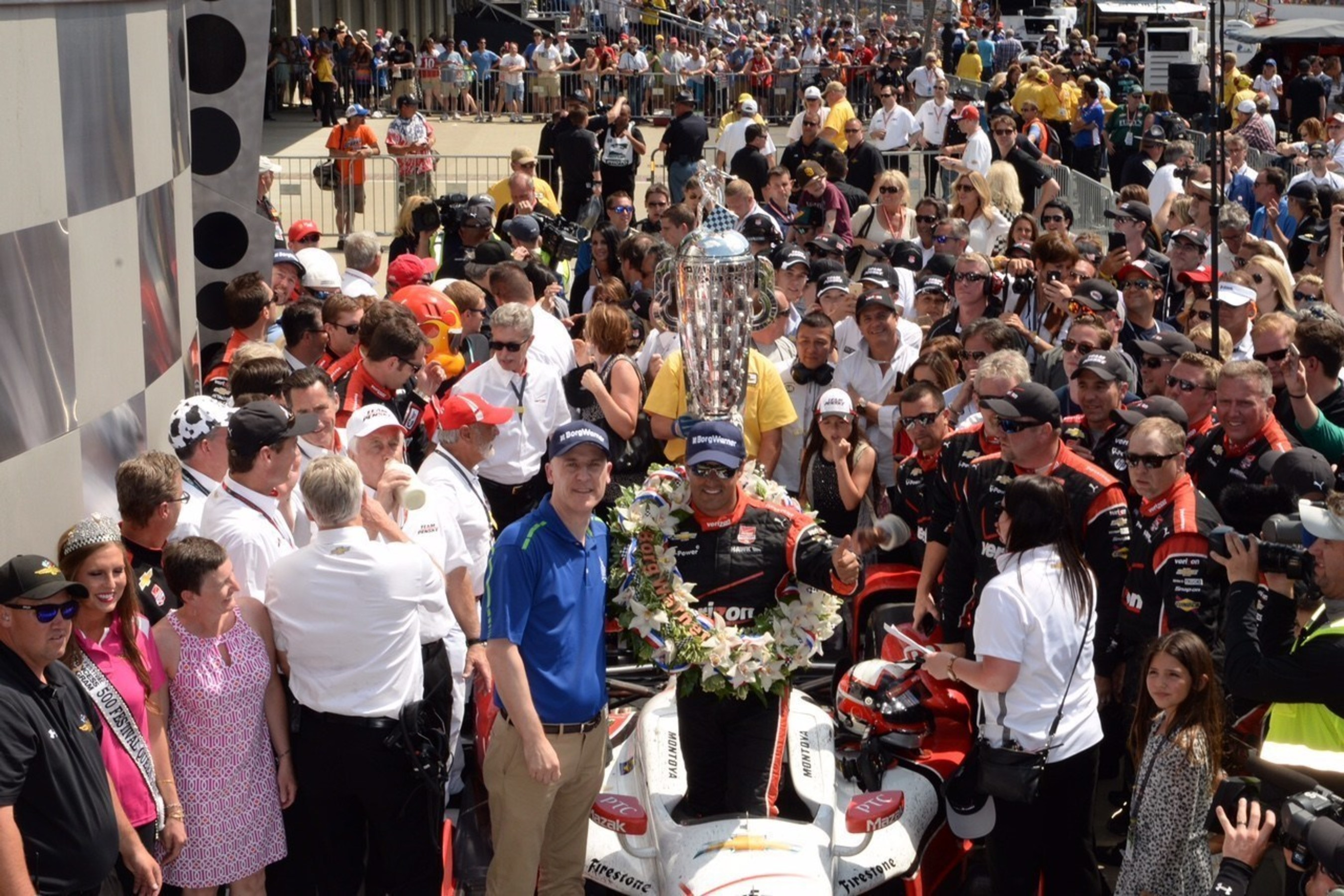 Standing beside the Borg-Warner Trophy(TM) in Victory Lane, BorgWarner President and Chief Executive Officer James Verrier congratulated Juan Pablo Montoya on his victory at the Indianapolis 500.