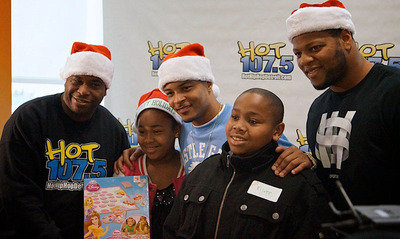 (L to R) Hot 107.5 Big Greg, T.I. and Ndamukong Suh.  (PRNewsFoto/DMC Children's Hospital of Michigan)