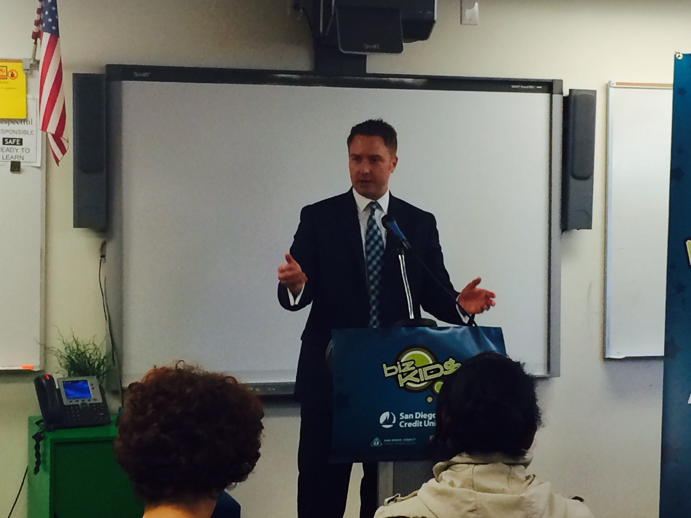 SDCCU Executive Vice President of Marketing and Business Development Nathan Schmidt discusses the SDCCU Biz Kid$ Program and the long-term economic benefits of financial education at a press conference held Friday, May 22, 2015 at Monarch School in San Diego.