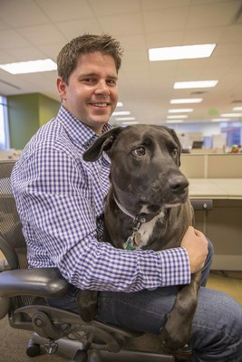 Mars Petcare Associate Chris Sumrall and his Labrador mix Lilly sit together at the office. While Friday, June 24 is International Take Your Dog to Work Day, Franklin, Tenn.-based Mars Petcare welcomes its 4-legged Associates year-round.