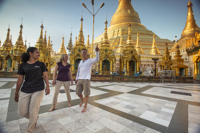 A Chief Experience Officer (CEO) leads travelers among the golden pagodas of Shwezigon in Bagan, Myanmar (Burma).(C) G Adventures, Inc.