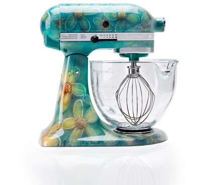 KitchenAid will offer hand-painted, limited editions of its iconic stand mixer for the holiday season.  The six original designs include Leopard, Snow Leopard and Noir Leopard; a zebra-striped Serengeti model; a floral-inspired Golden Petals design; and Shimmer(pictured), featuring the artist's signature blue flowers.  To order please visit http://www.shopkitchenaid.com/custommade.  (PRNewsFoto/KitchenAid)