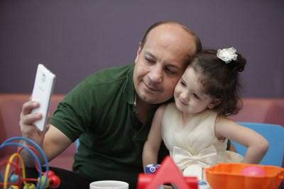 3 year old Salma with her father Mustafa (PRNewsFoto/Moorfields Eye Hospital Dubai)