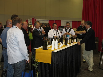 Tom Mueller, author of Extra Virginity: The Sublime and Scandalous World of Olive Oil, speaking to Retailers about olive oil at the 2013 KeHE Holiday Selling & Innovation Show.  (PRNewsFoto/KeHE Distributors, LLC)