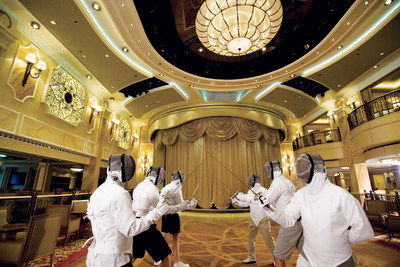 Fencing is among several skills that some passengers on cruise ships enjoy learning while on vacation.  (Photo courtesy of Cunard Line)