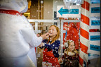 Children enjoy a winter wonderland at San Francisco International Airport on Dec. 6, 2014.