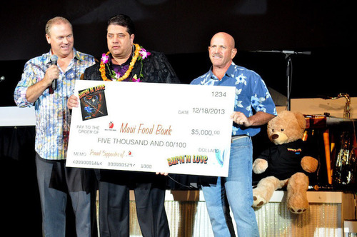(L to R) Burn'n Love General Manager, Rick Dunaj and Executive Producer Mike Kattawar present $5,000 donation to Maui Food Bank Executive Director Richard Yust. (PRNewsFoto/Burn'n Love) (PRNewsFoto/BURN'N LOVE)
