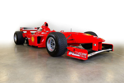 Milton Verret's 1998 Ferrari F300 Formula One (F1) racing car, driven by F1 World Champion Michael Schumacher. Milton Verret's F1 Ferrari will be sold along with 75 other rare cars at the Motostalgia Grand Prix Auction to be held on November 16 as part of the 2013 United States Formula 1 Grand Prix weekend in Austin, Texas.  (PRNewsFoto/Milton Verret)