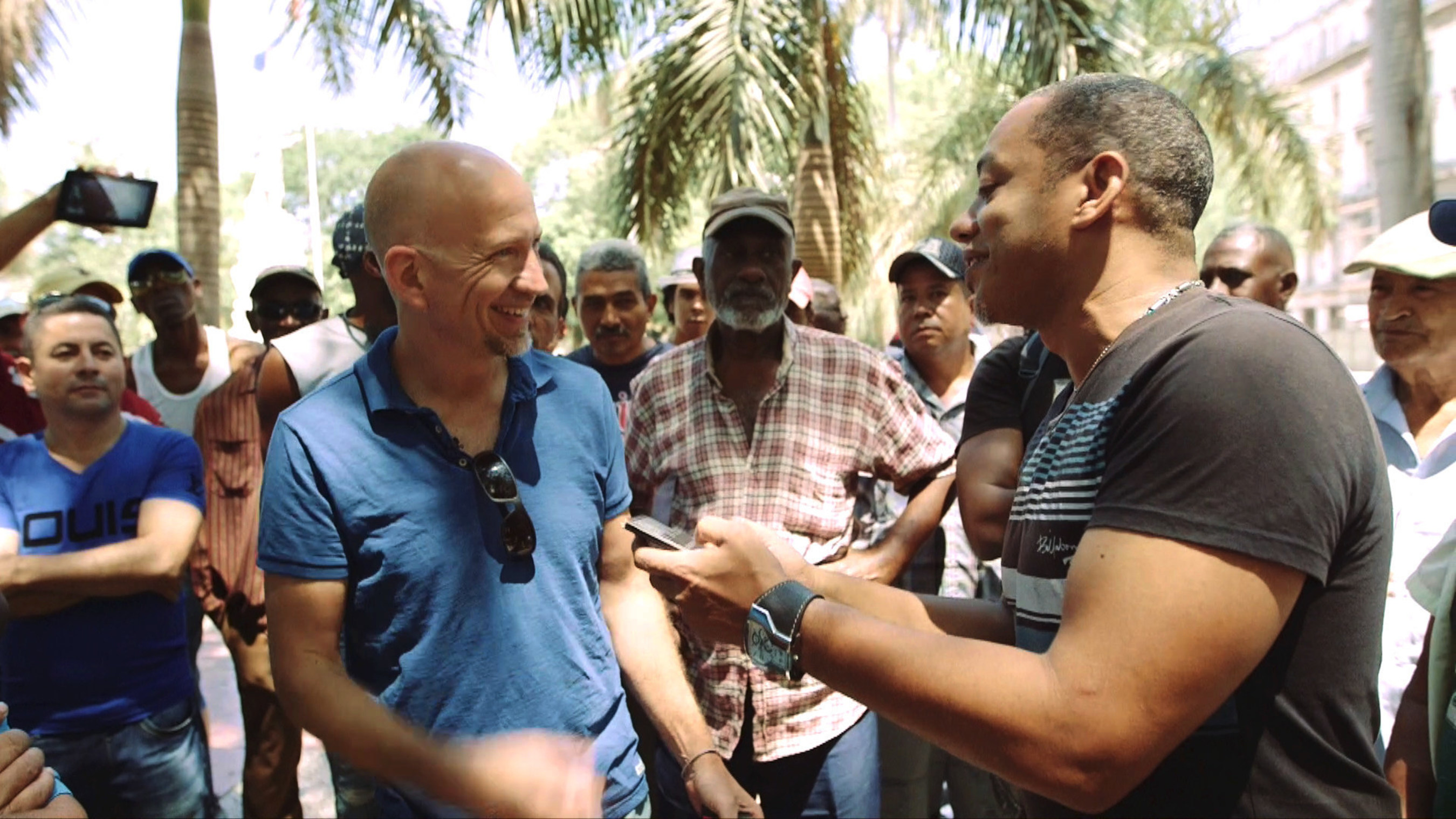REINVENTING CUBA.  Documentary Host and Correspondent Gerry Hadden (left) meets the people of Cuba in a revealing new documentary about a changing Cuba produced by CCTV America. Cut off from America by decades of hostility, living in conditions of scarcity and political restrictions, the Cubans emerge here as a people making something out of nothing with whatever is at hand.  Hadden portrays vibrant, hopeful, and resourceful characters facing enormous challenges in today's Cuba.