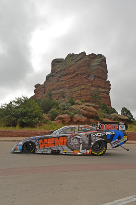 "A full slate of activities for the Mopar Mile High National Hot Rod Association (NHRA) Nationals was kicked off on Thursday morning at Red Rocks Park, a dramatic geological formation near Bandimere Speedway, by the firing-up of the Don Schumacher Racing Dodge (DSR) Charger R/T Funny Car driven by Matt Hagan in order to ""wake-up Denver"" and let fans know Mopar drivers and teams are in town and revving to get the weekend started. (PRNewsFoto/Chrysler Group LLC)"