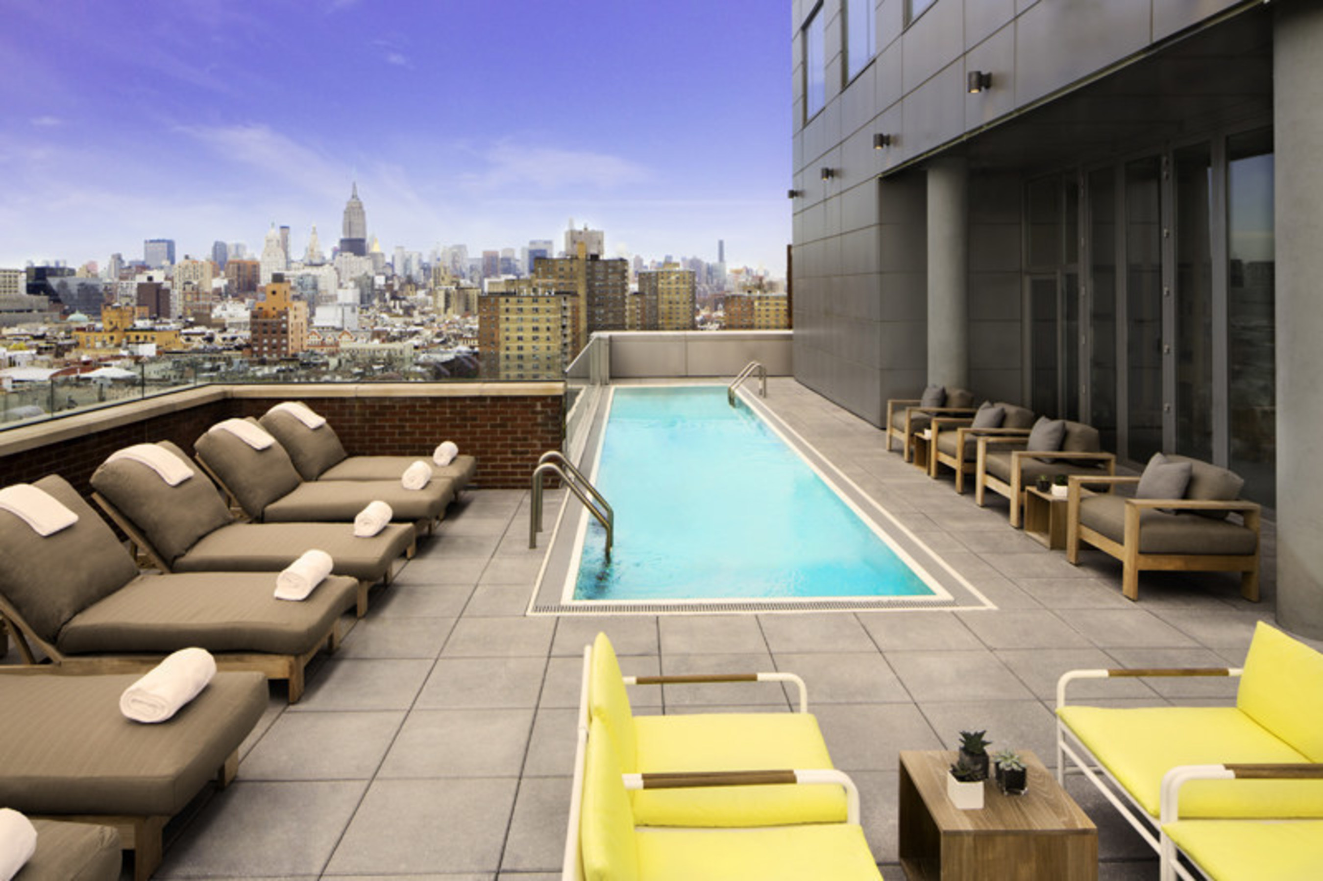 The impressive 5,000 sq. ft. terrace located on the west side of the 15th floor offers breathtaking views of Manhattan and is outfitted with its own swimming pool, bar and a variety of seating options - providing the perfect backdrop to enjoy locally crafted cocktails from the hotel's rooftop bar & restaurant, Mr. Purple.