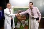 Hawn presents Dr. Hwang Woo-Suk with a custom oil painting on behalf of Bergin University of Canine Studies.