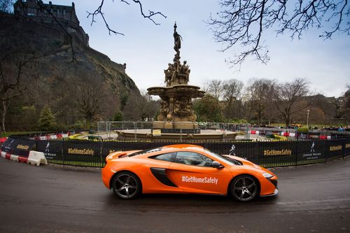 Jenson Button pictured driving a McLaren MP4-650S at a JOHNNIE WALKER driving spectacular in Edinburgh as part of the JOHNNIE WALKER responsible drinking campaign to give away 250,000 kilometres of safe rides home around the world during the festive season (PRNewsFoto/Johnnie Walker)