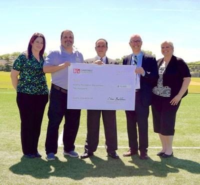 Robert Reyes, general manager of the BJ's Wholesale Club in Kearny presents a $10,000 grant to Mayor of Kearny Alberto G. Santos and local officials to benefit the Kearny Recreation Department.Pictured from left to right:1st Ward Councilwoman Marytrine De Castro, Kearny Director of Parks and Recreation Ralph Cattafi, BJ's General Manager in Kearny Robert Reyes, Mayor of Kearny Alberto Santos and from the Recreation Commissioners, Chairwoman Lyla DeCastro Lawdanski