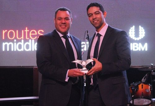 "Winner Khalil Lamrabet, Director of Aviation Business Development, Dubai Airports accepting on behalf of Dubai International Airport with Adrian Newton, Group Director âeuro"" Aviation and Technology Director, UBM EMEA. (PRNewsFoto/UBM EMEA Routes Ltd)"