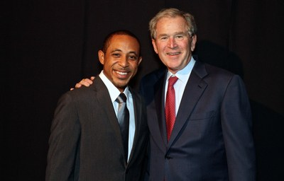 Former President George W. Bush and Dale Godboldo. Photo credit: Dennis Manuel