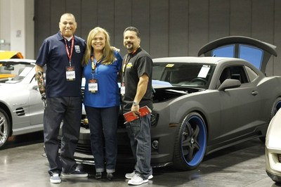 Preparing for the auction of the LINE-X Camaro with proceeds being donated to Operation Mend, from the left - Operation Mend veteran Octavio Sanchez, LINE-X's Director of Marketing Teppy Wigington and LINE-X of Torrance franchisee Herb Grageda.
