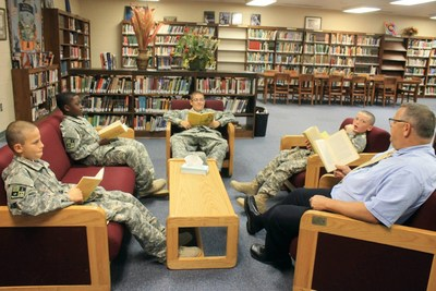 St. John's Military School 6th grade teacher Dan Jones, gets out from behind their desks whenever possible. Here, they read and discuss Old Yeller, the classic tale about a boy and his dog.