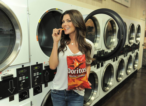 "Iconic ""Doritos Girl"" Ali Landry celebrates the 15th anniversary of her first Doritos Super Bowl spot ""Laundromat"" by announcing the finalists in this year's Doritos Crash the Super Bowl program.  (PRNewsFoto/Frito-Lay North America)"