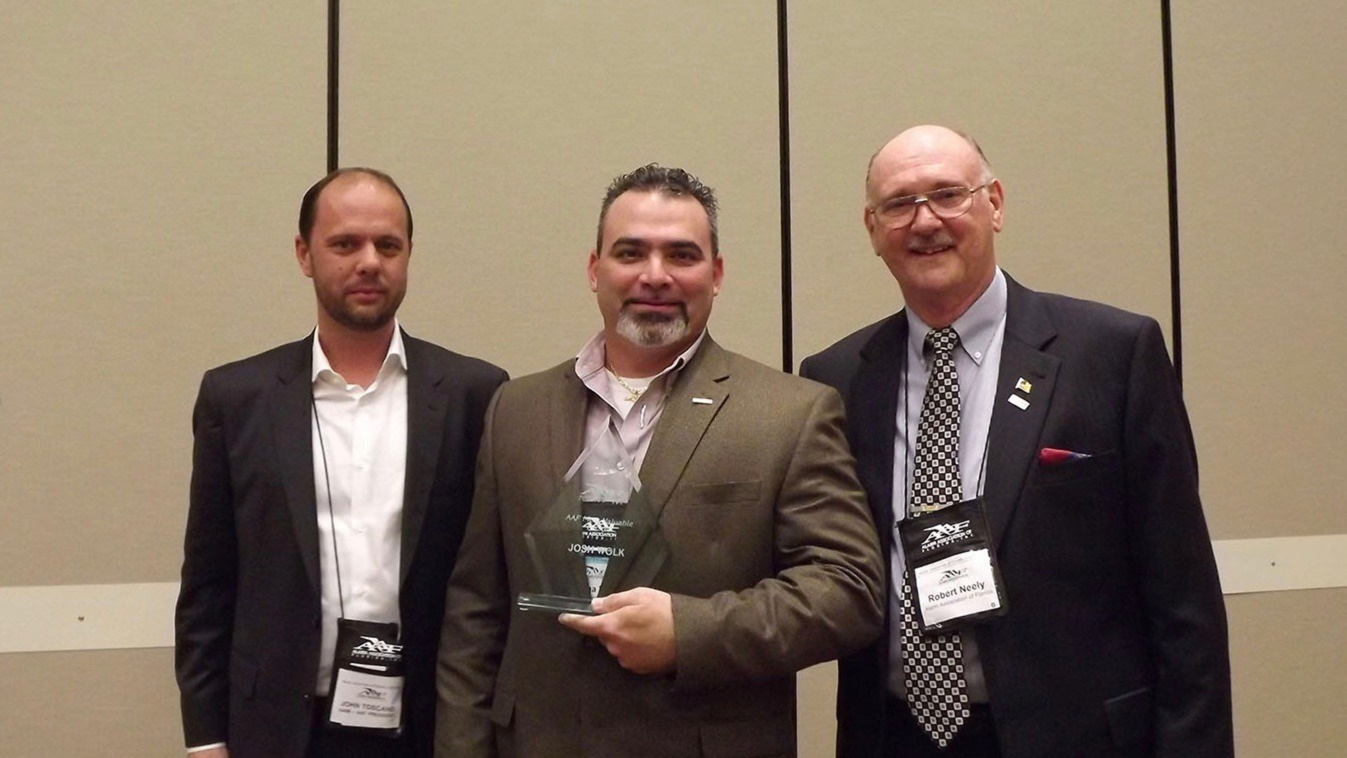 Red Hawk Fire & Security National Account Manager, Josh Wolk Named 2015 Most Valuable Person (MVP) by Alarm Association of Florida for his commitment to professional educational training for burglar and fire alarm agents in Florida. AAF Pres. John Toscano (left) and AAF Exec. Dir. Bob Neely (right) present award to Red Hawk's Josh Wolk (center).