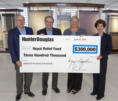 Marv Hopkins, Hunter Douglas Chairman & CEO, and Ron Kass, Hunter Douglas President & COO, presented the check to Kim Svoboda, Corporate Development Officer for Habitat. Shown above, from left to right, Ron Kass, Hunter Douglas President & COO; Marv Hopkins, Hunter Douglas Chairman & CEO; Kim Svoboda, Corporate Development Officer for Habitat; and Mindy Fabrikant, Hunter Douglas Vice President of Corporate Human Resources.
