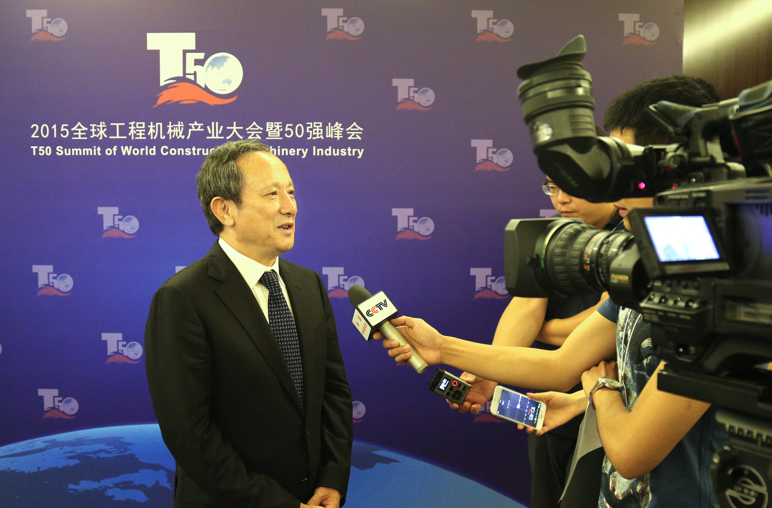 Wang Min, chairman and president of XCMG is interviewed by media at T50 Summit