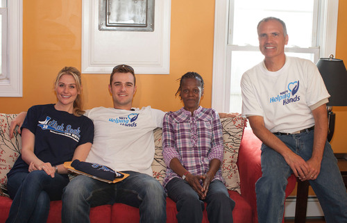 Erin and David Robertson from High Socks for Hope, homeowner Lillie Thompson and NBTY Helping Hands Chairman Mike Oliveri, sit on one of Lillie's new couches.  (PRNewsFoto/NBTY)
