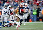 New England Patriots wide receiver Julian Edelman (11) runs the ball during an NFL football game against the Detroit Lions at Gillette Stadium on Sunday, November 23, 2014 in Foxborough, Massachusetts. New England won 34-9. (AP Photo/Aaron M. Sprecher)