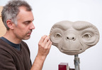 Madame Tussauds' sculptor Dan Woodley puts the finishing touches to the perfect clay sculpture that will be used as a blueprint for the wax figure of  the legendary film character E.T. who will be immortalised on 22nd October at five attractions around the world London, Amsterdam, Berlin, Sydney and Hollywood and in Tokyo in March 2013. This unveiling celebrates the Blu-ray release and the 30th anniversary of Steven Spielberg's beloved classic film E.T. The Extra-Terrestrial.  (PRNewsFoto/Madame Tussauds Hollywood)