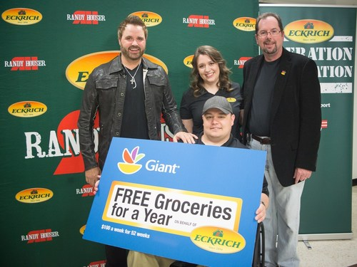 Air Force Staff Sergeant Christopher Solso and his wife, Clare, are presented free groceries for a year and a ...