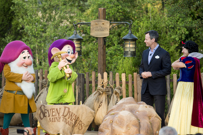 "SEVEN DWARFS MINE TRAIN COASTER DEDICATED AT WALT DISNEY WORLD (May 2, 2014):  Tom Staggs, chairman of Walt Disney Parks & Resorts, joins Disney characters Sleepy Dwarf, Dopey and Snow White May 2, 2014 in the Magic Kingdom park at Walt Disney World Resort in Lake Buena Vista, Fla., to dedicate the park's newest attraction, the Seven Dwarfs Mine Train.  The attraction, which will open to guests May 28, is a family-style coaster that immerses guests in playful and musical scenes inspired by the Disney animated classic film, ""Snow White and the Seven Dwarfs.""  The attraction completes New Fantasyland, the largest expansion in the history of the Magic Kingdom. (Ryan Wendler, photographer) (PRNewsFoto/Walt Disney World)"