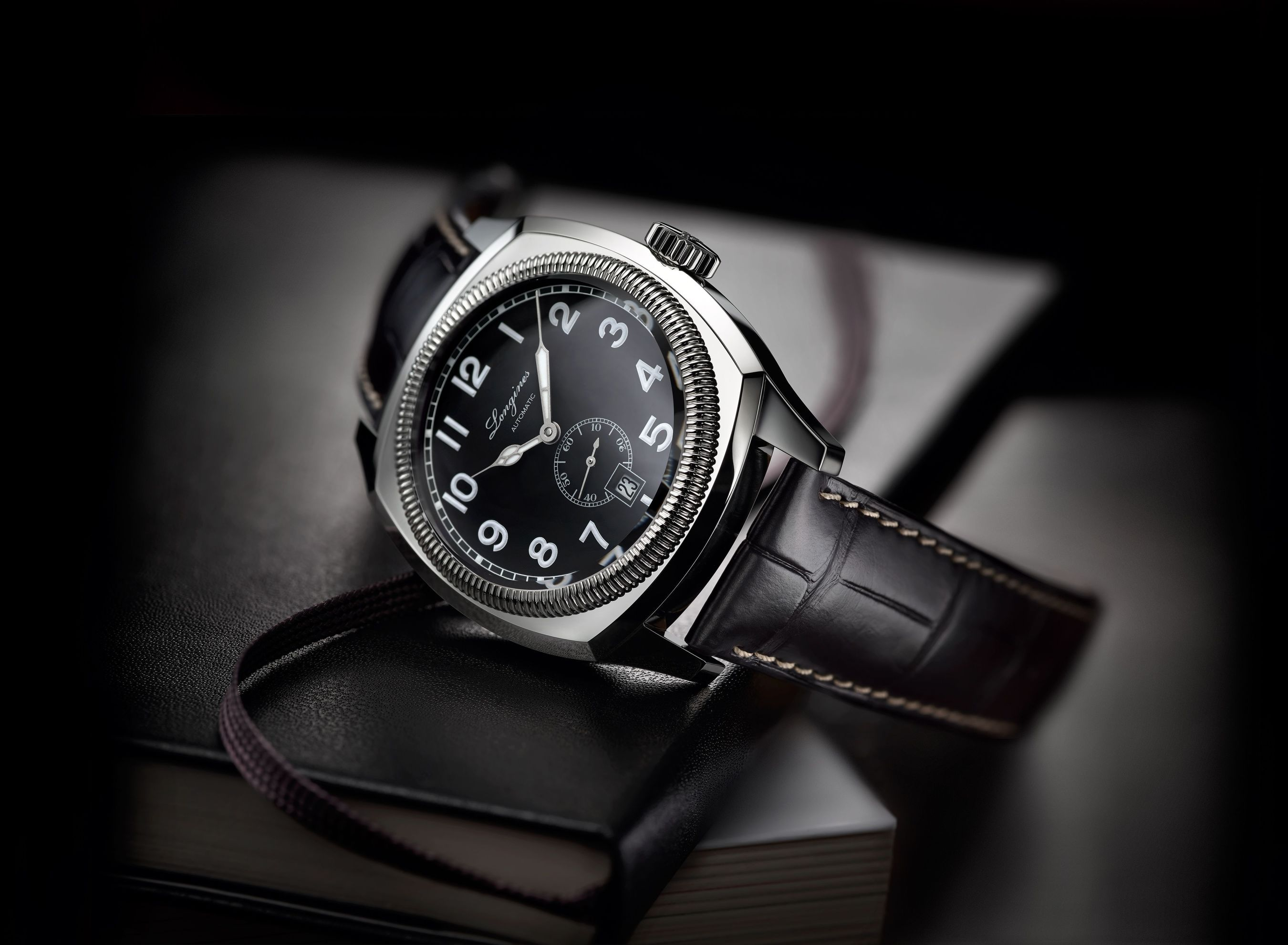 The Longines Heritage 1935 is based on a timepiece originally created for aviators but which went on to prove highly popular among the general public. Its cushion-shaped steel case has a diameter of 42 mm and houses the automatic calibre L615. The matt black dial displays white Arabic numerals with Super-LumiNova® as well as a small second and the date at 6 o'clock. The watch is fitted with a black alligator strap. (PRNewsFoto/Longines)